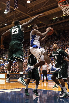 DURHAM, NC - DECEMBER 01:  Kyrie Irving #1 of the Duke Blue Devils drives to the basket during their game against Draymond Green #23 of the Michigan State Spartans at Cameron Indoor Stadium on December 1, 2010 in Durham, North Carolina.  (Photo by Streete