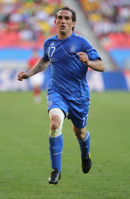 PORT ELIZABETH, SOUTH AFRICA - JUNE 12: Theofanis Gekas of Greece in action during the 2010 FIFA World Cup South Africa Group B match between South Korea and Greece at Nelson Mandela Bay Stadium on June 12, 2010 in Port Elizabeth, South Africa.  (Photo by