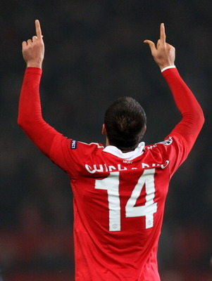 MANCHESTER, ENGLAND - MARCH 15:  Javier Hernandez (R) of Manchester United celebrates as he  scores the second goal during the UEFA Champions League round of 16 second leg match between Manchester United and Marseille at Old Trafford on March 15, 2011 in