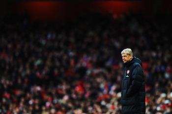 LONDON, UNITED KINGDOM - JANUARY 22:  Arsene Wenger the Arsenal manager watches from the touchline during the Barclays Premier League match between Arsenal and Wigan Athletic at the Emirates Stadium on January 22, 2011 in London, England.  (Photo by Mike