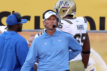 TEMPE, AZ - NOVEMBER 26:  Head coach Rick Neuheisel of the UCLA Bruins watches from the sidelines during the college football game against the Arizona State Sun Devils at Sun Devil Stadium on November 26, 2010 in Tempe, Arizona. The Sun Devils defeated th