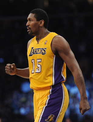 LOS ANGELES, CA - MARCH 31:  Ron Artest #15 of the Los Angeles Lakers reacts after his three pointer against the Dallas Mavericks at Staples Center on March 31, 2011 in Los Angeles, California.  NOTE TO USER: User expressly acknowledges and agrees that, b
