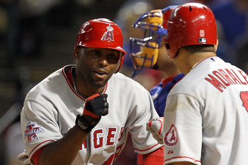 ARLINGTON, TX - MAY 17: Torii Hunter #48 of the Los Angeles Angels of Anaheim celebrates a solo homerun with Kendry Morales #8 against the Texas Rangers on May 17, 2010 at Rangers Ballpark in Arlington, Texas. (Photo by Ronald Martinez/Getty Images)