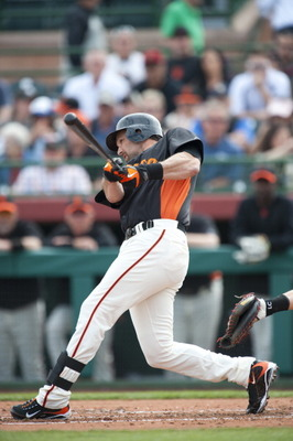 SCOTTSDALE, AZ - FEBRUARY 25: Mark DeRosa #7 of the San Francisco Giants bats during a spring training game against the Arizona Diamondbacks at Scottsdale Stadium on February 25, 2011 in Scottsdale, Arizona. (Photo by Rob Tringali/Getty Images)