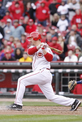 CINCINNATI, OH - MARCH 31: Scott Rolen #27 of the Cincinnati Reds hits the ball in the ninth inning against the Milwaukee Brewers in the opening day game at Great American Ballpark on March 31, 2011 in Cincinnati, Ohio. The Reds won 7-6. (Photo by Joe Rob