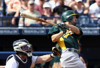PEORIA, AZ - MARCH 06:  David DeJesus #12 of the Oakland Athletics bats against the San Diego Padres during the spring training game at Peoria Stadium on March 6, 2011 in Peoria, Arizona.  (Photo by Christian Petersen/Getty Images)