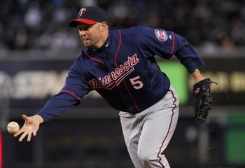 NEW YORK, NY - APRIL 05: Michael Cuddyer #5 of the Minnesota Twins tosses the ball to first against the New York Yankees at Yankee Stadium on April 5, 2011 in the Bronx borough of New York City.  (Photo by Nick Laham/Getty Images)