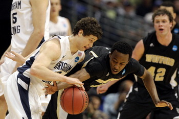DENVER, CO - MARCH 17:  Jamar Diggs #5 of the Wofford Terriers defends against Jimmer Fredette #32 of the Brigham Young Cougars during the second round of the 2011 NCAA men's basketball tournament at Pepsi Center on March 17, 2011 in Denver, Colorado.  (P