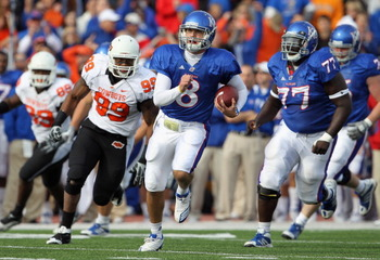 LAWRENCE, KS - NOVEMBER 20:   Quarterback Quinn Mecham #8 of the Kansas Jayhawks scrambles during the game against the Oklahoma State Cowboys on November 20, 2010 at Memorial Stadium in Lawrence, Kansas.  (Photo by Jamie Squire/Getty Images)