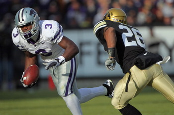 BOULDER, CO - NOVEMBER 20:  Wide receiver Chris Harper #3 of the Kansas State Wildcats makes a pass reception as safety Ray Polk #26 of the Colorado Buffaloes defends at Folsom Field on November 20, 2010 in Boulder, Colorado. Colorado defeated Kansas Stat