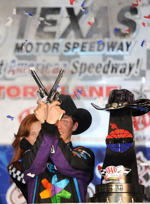 FORT WORTH, TX - NOVEMBER 07:   Denny Hamlin, driver of the #11 FedEx Office Toyota, shoots a Turnbull Revolvers in Victory Lane after winning the NASCAR Sprint Cup Series AAA Texas 500 at Texas Motor Speedway on November 7, 2010 in Fort Worth, Texas.  (P