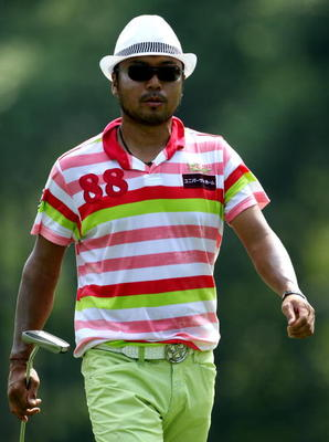KUALA LUMPUR, MALAYSIA - MARCH 05:  Shingo Katayama of Japan walks towards his ball on the first hole during the the second round of the Maybank Malaysian Open at the Kuala Lumpur Golf and Country Club on March 5, 2010 in Kuala Lumpur, Malaysia.  (Photo b