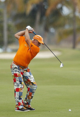 RIO GRANDE, PR - MARCH 10: John Daly hits a shot from the fairway during the first round of the Puerto Rico Open presented by seepuertorico.com at Trump International Golf Club on March 10, 2011 in Rio Grande, Puerto Rico.  (Photo by Michael Cohen/Getty I