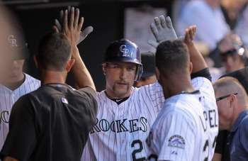 Chris Iannetta is congratulated in the Rockies dugout by his teammates after hitting a home run off of the Dodgers Clayton Kershaw in a 3-0 win on Tuesday, April 5th.