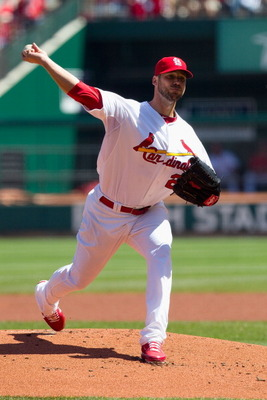 ST. LOUIS, MO - APRIL 6: Starter Chris Carpenter #29 of the St. Louis Cardinals pitches against the Pittsburgh Pirates at Busch Stadium on April 6, 2011 in St. Louis, Missouri.  (Photo by Dilip Vishwanat/Getty Images)