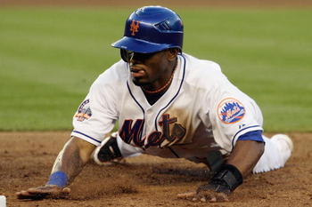 NEW YORK - JUNE 11: Jose Reyes #7 of the New York Mets dives back to first base against the Arizona Diamonbacks on June 11, 2008 at Shea Stadium in the Flushing neighborhood of the Queens borough of New York City. (Photo by Jim McIsaac/Getty Images)