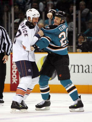 SAN JOSE, CA - JANUARY 02: Ryane Clowe #29 of the San Jose Sharks and Jason Strudwick #43 of the Edmonton Oilers get in a fight at HP Pavilion on January 2, 2010 in San Jose, California. (Photo by Ezra Shaw/Getty Images)