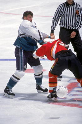 ANAHEIM, CA - OCTOBER 29:  Todd Ewen #36 of the Mighty Ducks of Anaheim and Paul Kruse #12 of the Calgary Flames exchange blows during a game at The Arrowhead Pond of Anaheim on October 29, 1995 in Anaheim, California.  The Ducks won 7-2.  (Photo by Glenn