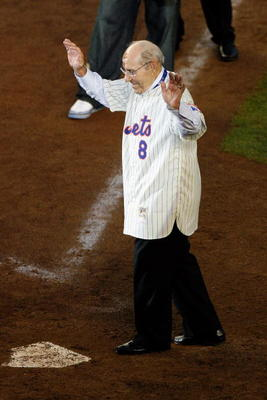 NEW YORK - SEPTEMBER 28:  Former Mets manager Yogi Berra greets fans from the field in a post game ceremony after the last regular season baseball game ever played in Shea Stadium against the Florida Marlins on September 28, 2008 in the Flushing neighborh