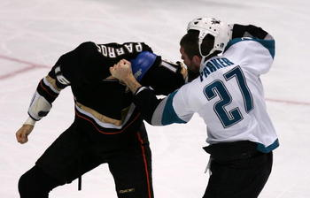 ANAHEIM, CA - NOVEMBER 20:  George Parros #16 of the Anaheim Ducks fights with Scott Parker #27 of the San Jose Sharks during the second period of a NHL game at the Honda Center November 21, 2006 in Anaheim, California.  (Photo by Robert Laberge/Getty Ima