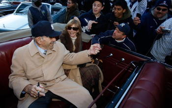 NEW YORK - NOVEMBER 06:  Former New York Yankee Yogi Berra shakes hands with a fan before the New York Yankees World Series Victory Parade on November 6, 2009 in New York, New York.  (Photo by Jared Wickerham/Getty Images)