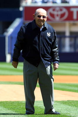 NEW YORK - APRIL 16:  Yogi Berra smiles after throwing the ceremonial first pitch before the opening day game between the Cleveland Indians and the New York Yankees at the new Yankee Stadium on April 16, 2009 in the Bronx borough of New York City. This is