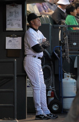Jim Tracy looks on during the Rockies opening homestand at Coors Field in April 2011