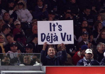 NEW YORK - OCTOBER 29:  A fan of the New York Yankees holds up a sign which reads 'It's Deja Vu' in reference to Hall of Famer Yogi Berra against the Philadelphia Phillies in Game Two of the 2009 MLB World Series at Yankee Stadium on October 29, 2009 in t