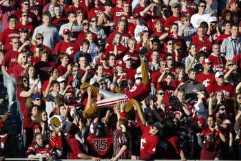 PULLMAN, WA - OCTOBER 21:  Washington State Cougars fans and their mascot cheer during the game against the Oregon Ducks on October 21, 2006 at Martin Stadium in Pullman, Washington. Washington State won 34-23. (Photo by Otto Greule Jr/Getty Images)