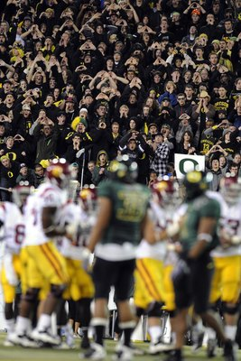 EUGENE, OR - OCTOBER 31:  Oregon Ducks fans make some noise on a Halloween night game against the USC Trojans at Autzen Stadium on October 31, 2009 in Eugene, Oregon. The crowd noise at Autzen Stadium is said to be one of the loudest in the nation and rep
