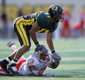 1 Sep 2001:  Rashad Bauman #17 of the Oregon Ducks holding down Lee Evans #3 during the game against the Wisconsin Badgers at Autzen Stadium in Eugene, Oregon. The Ducks defeated the Badgers 31-28.Mandatory Credit: Otto Greule  /Allsport