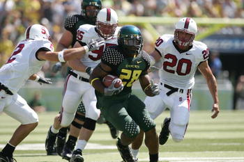 EUGENE, OR - SEPTEMBER 2:  Running back Jonathan Stewart #28 of the Oregon Ducks runs with the ball during the game against the Stanford Cardinal on September 2, 2006 at Autzen Stadium in Eugene, Oregon. The Ducks won 48-10.  (Photo by Jonathan Ferrey/Get