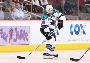 GLENDALE, AZ - MARCH 26:  Dan Boyle #22 of the San Jose Sharks skates with the puck during the NHL game against the Phoenix Coyotes at Jobing.com Arena on March 26, 2011 in Glendale, Arizona. The Sharks defeated the Coyotes 4-1.  (Photo by Christian Peter