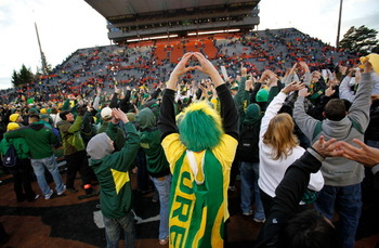 CORVALLIS, OR - DECEMBER 04:  Fans of the Oregon Ducks rush onto te field after te 37-20 victory over the Oregon State Beavers during the 114th Civil War on December 4, 2010 at the Reser Stadium in Corvallis, Oregon.  (Photo by Jonathan Ferrey/Getty Image