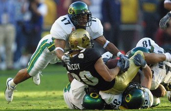 01 Jan 2002 :Rashad Bauman #17 of Oregon goes airborne over derek McCoy #80 of Colorado during the game at the  Fiesta Bowl at Sun Devil Stadium in Tempe, Arizona. The Oregon Ducks won 38-16. DIGITAL IMAGE. Mandatory Credit: Jeff Gross/Getty Images