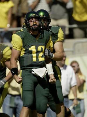 EUGENE, OR - SEPTEMBER 20:  Quarterback Jason Fife #12 of the University of Oregon Ducks celebrates after scoring a touchdown against the University of Michigan Wolverines on September 20, 2003 at Autzen Stadium in Eugene, Oregon. Oregon defeated Michigan