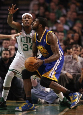 BOSTON, MA - MARCH 04:  Dorell Wright #1 of the Golden State Warriors tries to get around Paul Pierce #34 of the Boston Celtics on March 4, 2011 at the TD Garden in Boston, Massachusetts.  NOTE TO USER: User expressly acknowledges and agrees that, by down