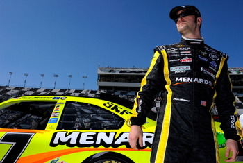 DAYTONA BEACH, FL - FEBRUARY 13:  Paul Menard, driver of the #27 Menards Chevrolet, stands on the grid during qualifying for the NASCAR Sprint Cup Series Daytona 500 at Daytona International Speedway on February 13, 2011 in Daytona Beach, Florida.  (Photo