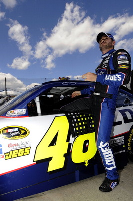 MARTINSVILLE, VA - APRIL 02:  Jimmie Johnson, driver of the #48 Lowe's Chevrolet, climbs out of his car after qualifying for the NASCAR Sprint Cup Series Goody's Fast Relief 500 at Martinsville Speedway on April 2, 2011 in Martinsville, Virginia.  (Photo