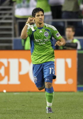 SEATTLE - AUGUST 08:  Fredy Montero #17 of the Seattle Sounders FC celebrates after scoring a goal against the Houston Dynamo on August 8, 2010 at Qwest Field in Seattle, Washington. The Sounders defeated the Dynamo 2-0. (Photo by Otto Greule Jr/Getty Ima