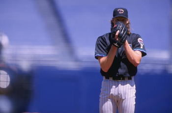 25 Apr 1999:  Pitcher Randy Johnson #51 of the Arizona Diamondbacks gets ready to pitch the ball during the game against the San Diego Padres at Qualcomm Stadium in San Diego, California. The Diamondbacks defeated the Padres 5-3. Mandatory Credit: Todd Wa