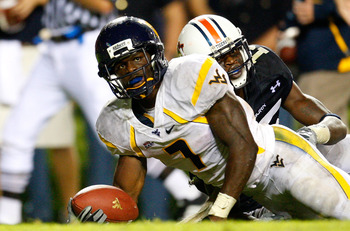 AUBURN, AL - SEPTEMBER 19:  Noel Devine #7 of the West Virginia Mountaineers scores a touchdown against Neiko Thorpe #15 of the Auburn Tigers at Jordan-Hare Stadium on September 19, 2009 in Auburn, Alabama.  (Photo by Kevin C. Cox/Getty Images)
