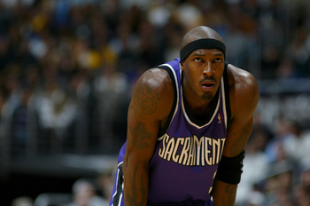 LOS ANGELES - FEBRUARY 26:  Gerald Wallace #3 of the Sacramento Kings rests during the game against the Los Angeles Lakers at Staples Center on February 26, 2004 in Los Angeles, California.  The Kings won 103-101.  NOTE TO USER: User expressly acknowledge