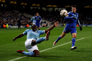 MANCHESTER, ENGLAND - MARCH 17: Micah Richards of Manchester City beats Goran Popov of Dynamo Kiev to the ball during the UEFA Europa League round of 16 second leg match between Manchester City and Dynamo Kiev at City of Manchester Stadium on March 17, 20