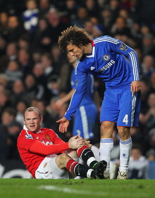 LONDON, ENGLAND - MARCH 01:  David Luiz of Chelsea offers his hand to Wayne Rooney of Manchester United during the Barclays Premier League match between Chelsea and Manchester United at Stamford Bridge on March 1, 2011 in London, England.  (Photo by Clive
