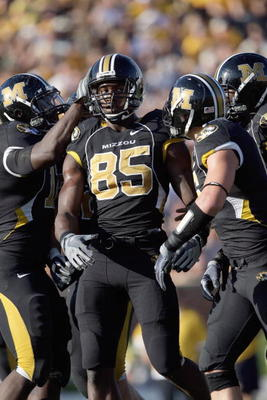 COLUMBIA, MO - NOVEMBER 7:  Aldon Smith #85 of the Missouri Tigers is congratulated by teammates during the game against the Baylor Bears at Faurot Field/Memorial Stadium on November 7, 2009 in Columbia, Missouri. (Photo by Jamie Squire/Getty Images)
