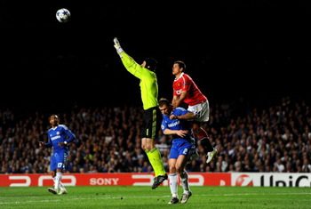 LONDON, ENGLAND - APRIL 06:  Goalkeeper Petr Cech of Chelsea claims the high ball as Javier Hernandez of Manchester United climbs up the back of Branislav Ivanovic of Chelsea during the UEFA Champions League quarter final first leg match between Chelsea a