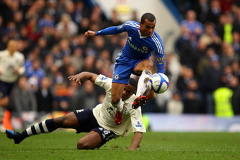 LONDON, ENGLAND - FEBRUARY 19:  Ashley Cole of Chelsea controls the ball as Victor Anichebe of Everton looks on during the FA Cup sponsored by E.ON 4th round replay match between Chelsea and Everton at Stamford Bridge on February 19, 2011 in London, Engla
