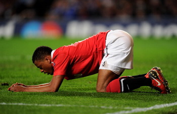 LONDON, ENGLAND - APRIL 06:  The injured Patrice Evra of Manchester United kneels on the pitch during the UEFA Champions League quarter final first leg match between Chelsea and Manchester United at Stamford Bridge on April 6, 2011 in London, England.  (P