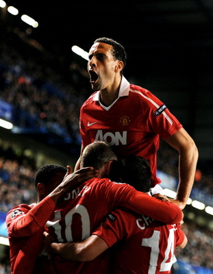 LONDON, ENGLAND - APRIL 06:  Rio Ferdinand (T) of Manchester United celebrates after teammate Wayne Rooney #10 of Manchester United scores the opening goal during the UEFA Champions League quarter final first leg match between Chelsea and Manchester Unite